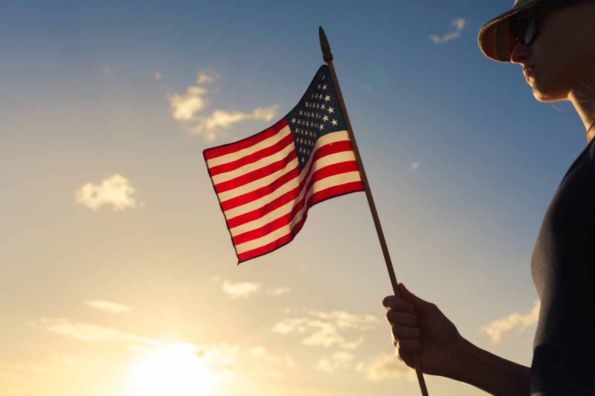 Woman holding a American flag.
